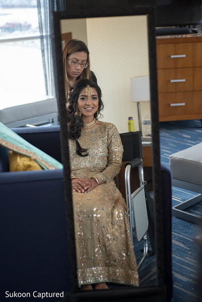 Indian bride glowing in her wedding reception attire.