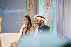 Adorable Indian lovebirds portrait at their wedding reception.
