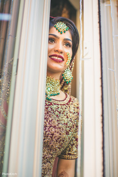 Sweet indian bride looking out the window