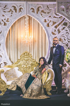 Indian couple posing at their fabulous stage