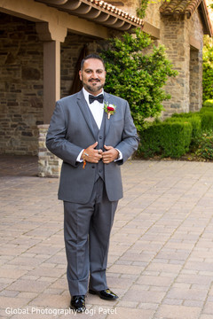 Indian groom posing for pictures outdoors prior to the ceremony
