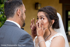 Indian bride has an emotional moment during the photo shoot