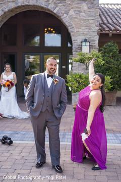 Fun capture of the Indian groom with joyful bridesmaid