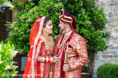 Indian bride and groom stare at each other during the photo shoot