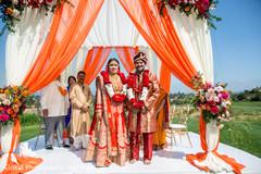 Indian newlyweds enjoying their ceremony