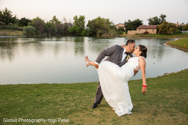 Lovely Indian bride and groom outdoors capture.
