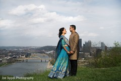 Beautiful overview of the city as background for the Indian couple