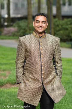 Portrait of the elegant Indian groom during pictures