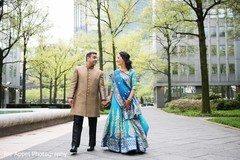 Indian bride and groom walk in the city during pictures