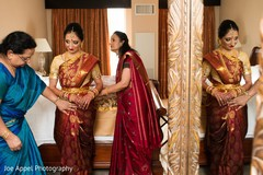 Special guests make sure the maharani looks radiant before the wedding