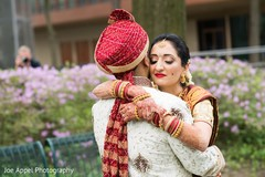 Tender moment between the maharani and Indian groom