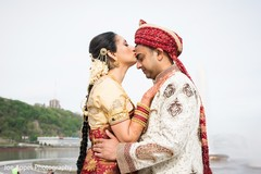 Indian bride kissing the Raja during the photo session