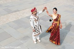 Indian groom dancing with the maharani for the photo shoot