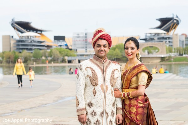 Lovely Indian bride and groom outdoors