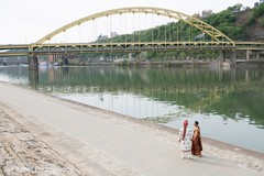 Amazing shot of the Indian couple walking next to the river