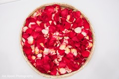 Basket with rose petals to be used at the Indian wedding