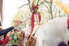 Raja greeting a guest during the fun baraat