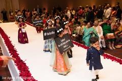 Indian wedding ceremonies start as the kids make their entrances