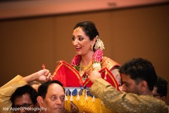 Joyful Indian bride smiling as she comes closer to the aisle