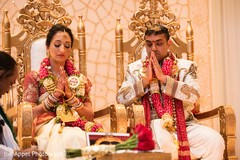 Indian bride and groom show respects during the ceremony