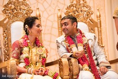 Indian groom and bride stare at each other during the ceremony