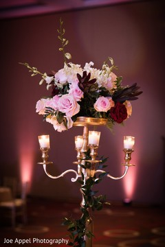 Chandelier and flower arrangement decorating the Indian wedding reception