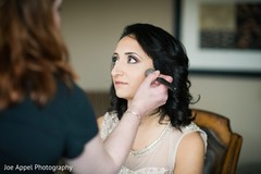 Beautiful maharani being assisted with her makeup