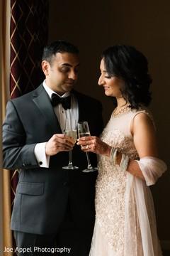 Indian newlyweds make a toast celebrating their union