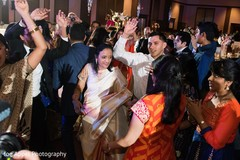Indian wedding guests having a great time during the reception