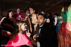 Indian groom having a blast with the guests at the Indian wedding reception