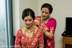 Maharani getting her ceremony necklace on.