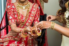 Maharani being given her bangles to put on.