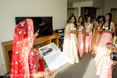 Dazzling indian bride with bridesmaids capture getting ready.