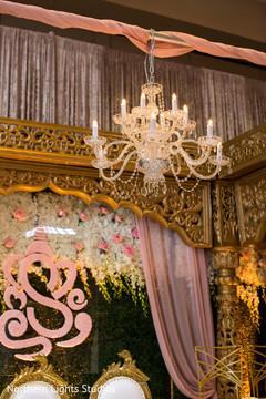 Elegant Indian wedding ceremony chandelier mandap decoration.