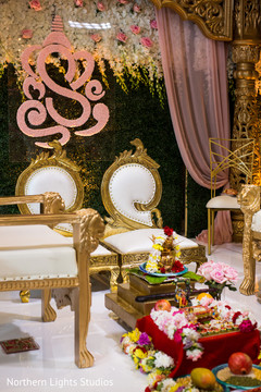 Mandap golden seats decoration.