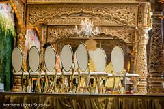 Stunning golden mandap seats decoration.