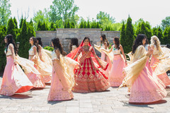 Sweet Indian bride and  bridesmaids posing for photo.