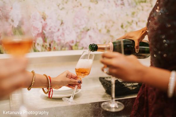 Close up of maharani and bridesmaids sharing champagne