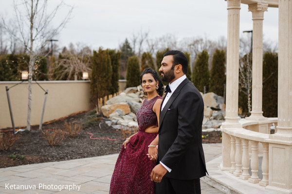 Indian couple holding hands outdoors for the photo shoot