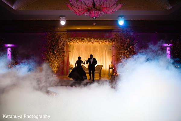 Amazing shot of the Indian couple surrounded with lightning
