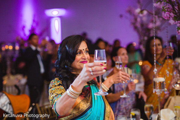Beautiful Indian guest toasting for the Indian newlyweds