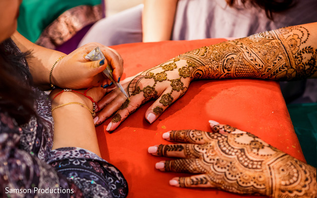 Mehndi artist assisting the maharani with her design