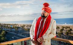 Portrait of Indian groom next to the ocean