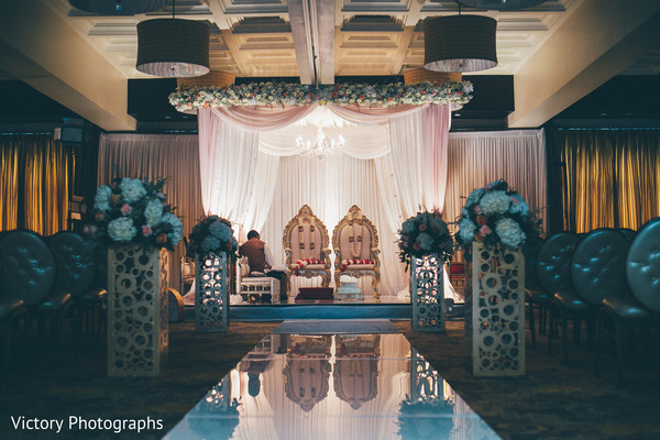 indian wedding stage,floral and decor,indoor mandap