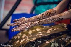 Indian bride getting mehndi art done