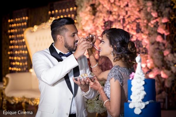 indian wedding,cake and treats,cake cutting