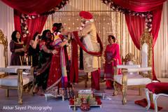 Indian wedding rituals continue under the beautiful mandap
