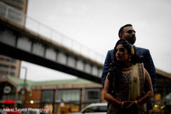 Indian couple posing for pictures outdoors