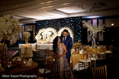 Radiant Indian newlyweds at the reception venue