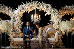 Indian newlyweds under the amazing flower and light decoration
